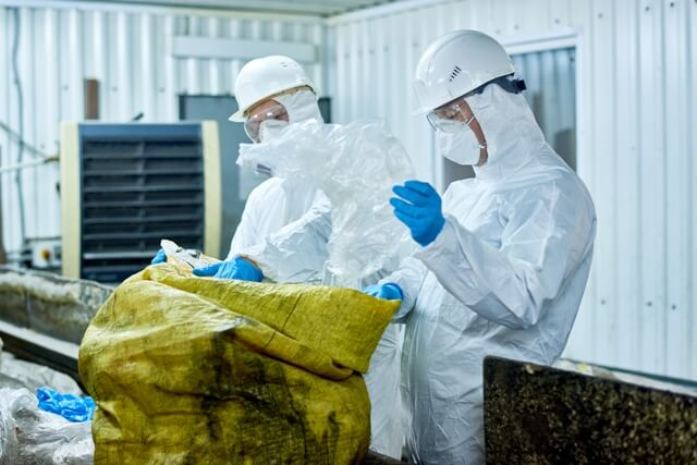 workers-separating-hazardous-waste-from-dumpster